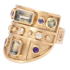 Green and Purple Sapphire Archer's Ring in 18 Karat Gold with Diamonds