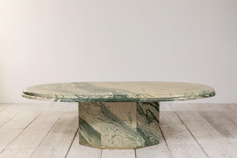 This green marbled cocktail table offers beautiful natural colorations along with its unique classic shape.