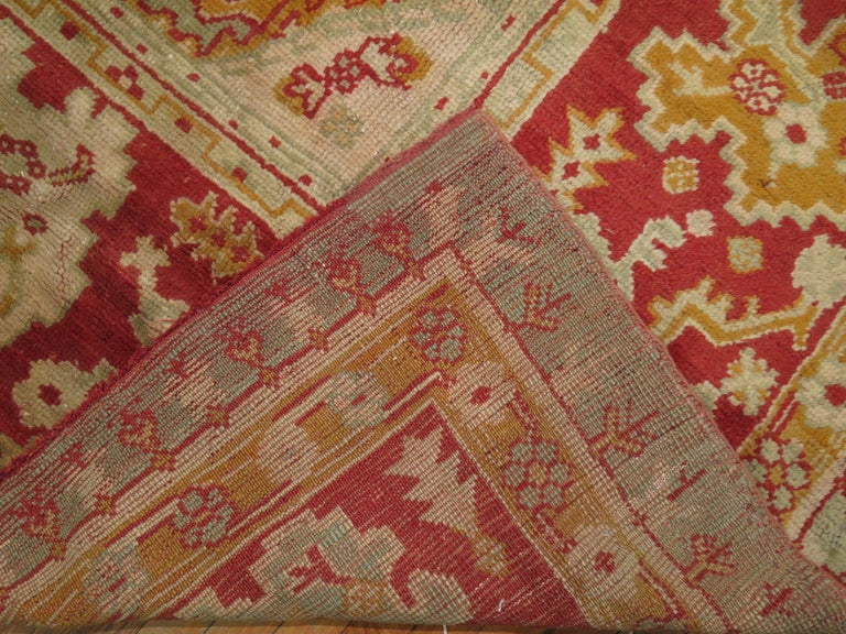 Hand-Woven Green Antique Oushak Rug For Sale
