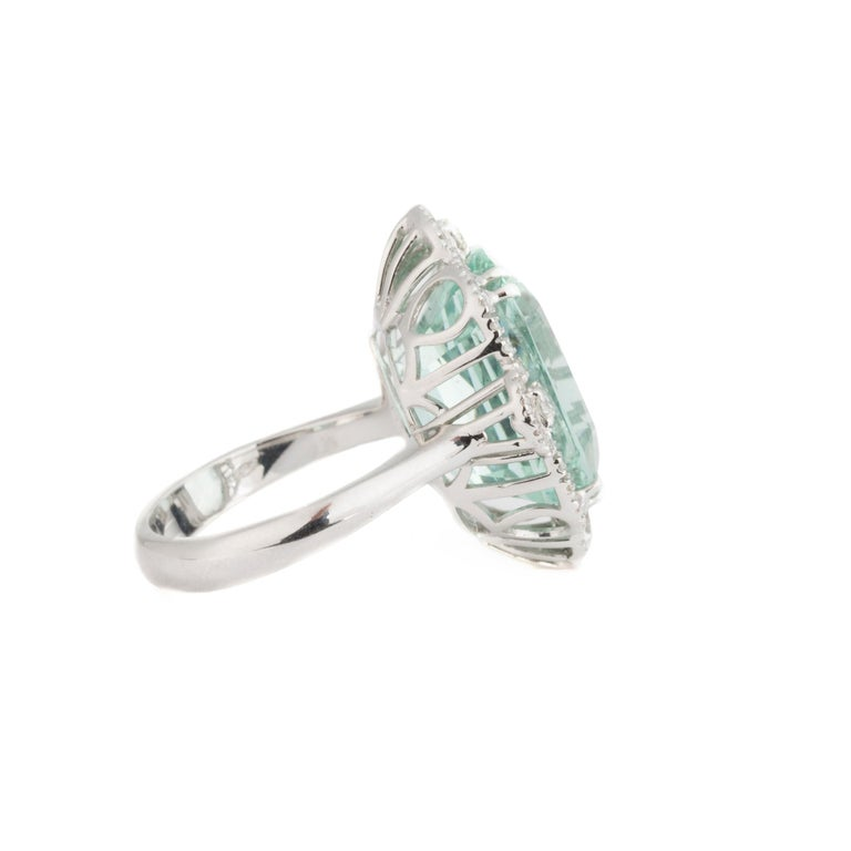 Modern Cut Green Aquamarine is the main feature of this Ring. It shows the beauty of the Gemstone. 12.33 Carat Aquamarine and 0.46 Carat Diamond set in 18 Karat White Gold.