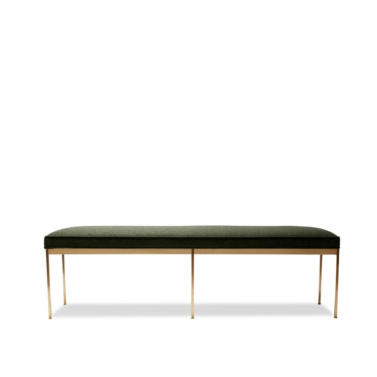 "The Paul bench features a solid lacquered brass base and an upholstered seat with piping. Each leg features a rounded leveler. Shown here in green boiled wool and satin brass. Measures: 60"".  The Lawson-Fenning collection is designed and handmade in"