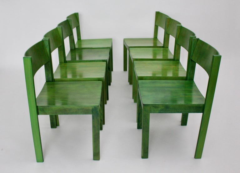 This set of 8 dining room chairs was designed by Carl Auböck, 1956, Vienna for the dormitory of Anna Boschek girl´s home and executed by E. & A. Pollak Vienna.  The dining room chairs were made of solid beechwood and plywood, carefully cleaned,
