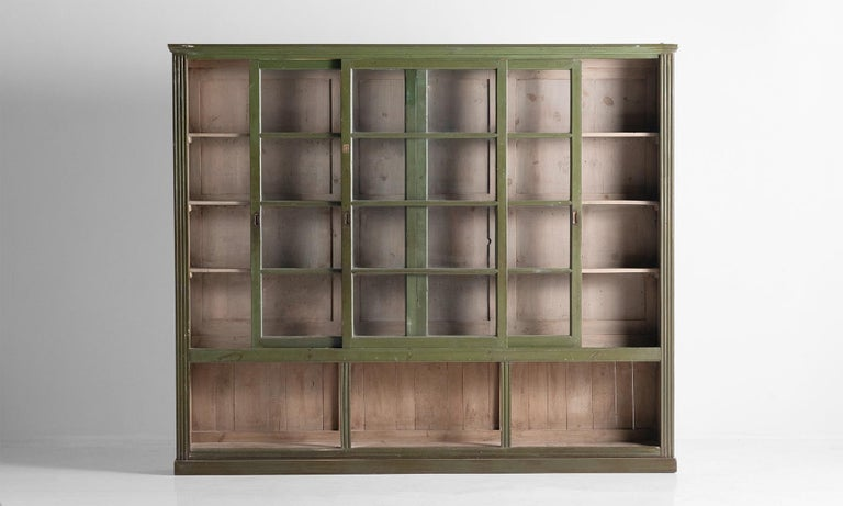 Unique display cabinet with sliding doors and original green paint.