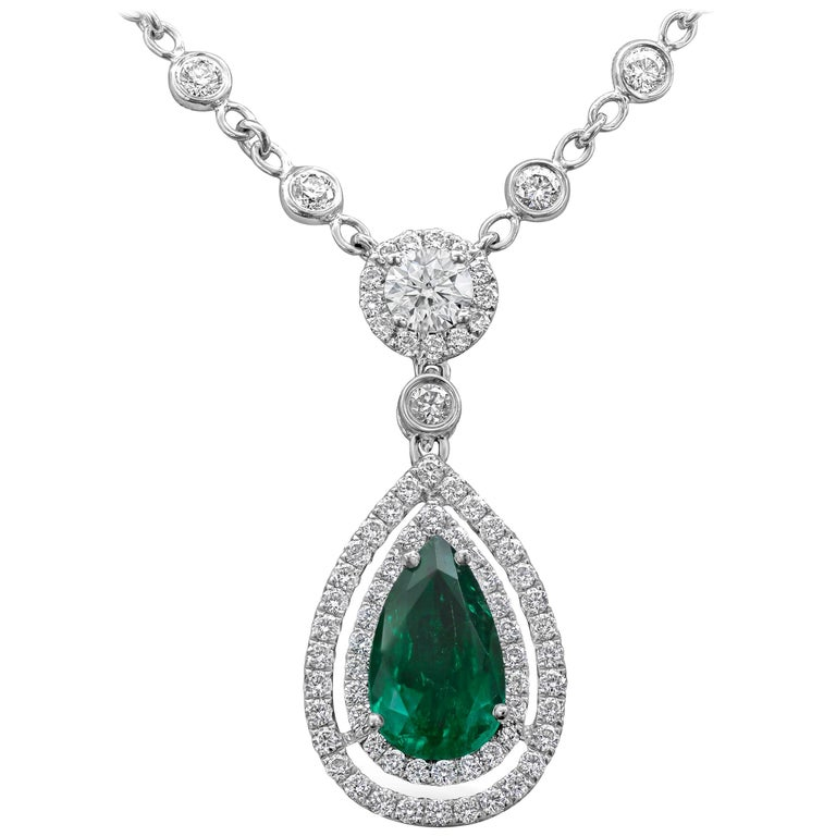 Green Emerald and Diamond Double Halo Drop Necklace For Sale
