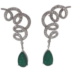 Green Emerald and Diamond Drop Swirl Earrings 28.47 Carat 18 Karat White Gold