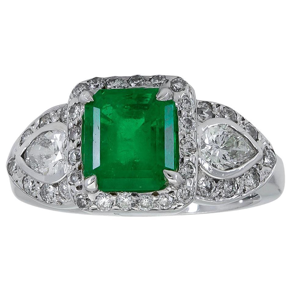 Green Emerald and Diamond Three-Stone Halo Engagement Ring