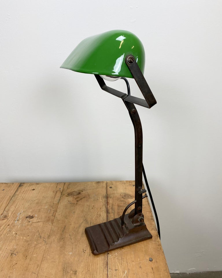Vintage green table lamp from 1930s in Bauhaus style. Cast iron base. Green enameled iron shade. White enameled interior. The arm and shade are adjustable. Porcelain socket for E 27 light bulbs. Fully functional. Dimensions of the lampshade: 22cm x