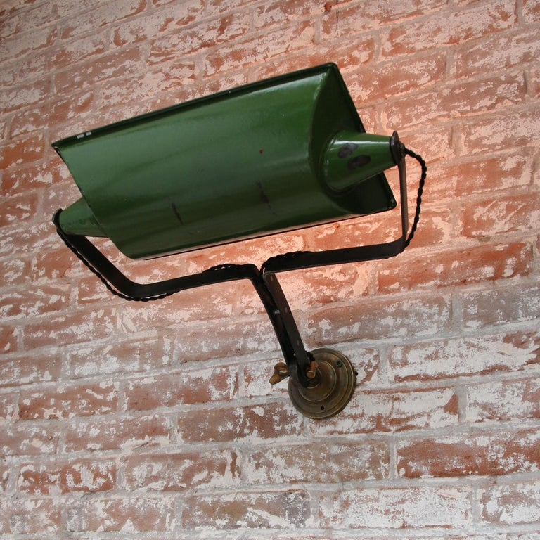 Large green enamel wall lamp scone made in the UK Metal arm with brass wall plate Adjustable in height and angle  2x E26 / E27  Measures: Diameter cast iron wall mount 10 cm.  Weight: 2.20 kg / 4.9 lb  Priced per individual item. All lamps