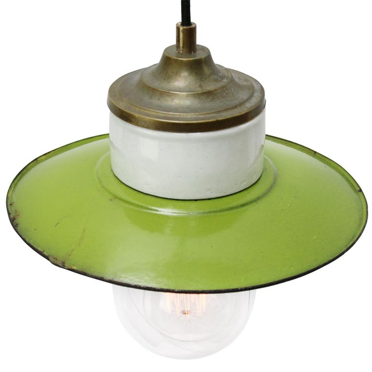 Porcelain industrial hanging lamp. Green porcelain, brass and clear glass. Enamel shade 2 conductors, no ground.  Weight: 1.40 kg / 3.1 lb  Priced per individual item. All lamps have been made suitable by international standards for
