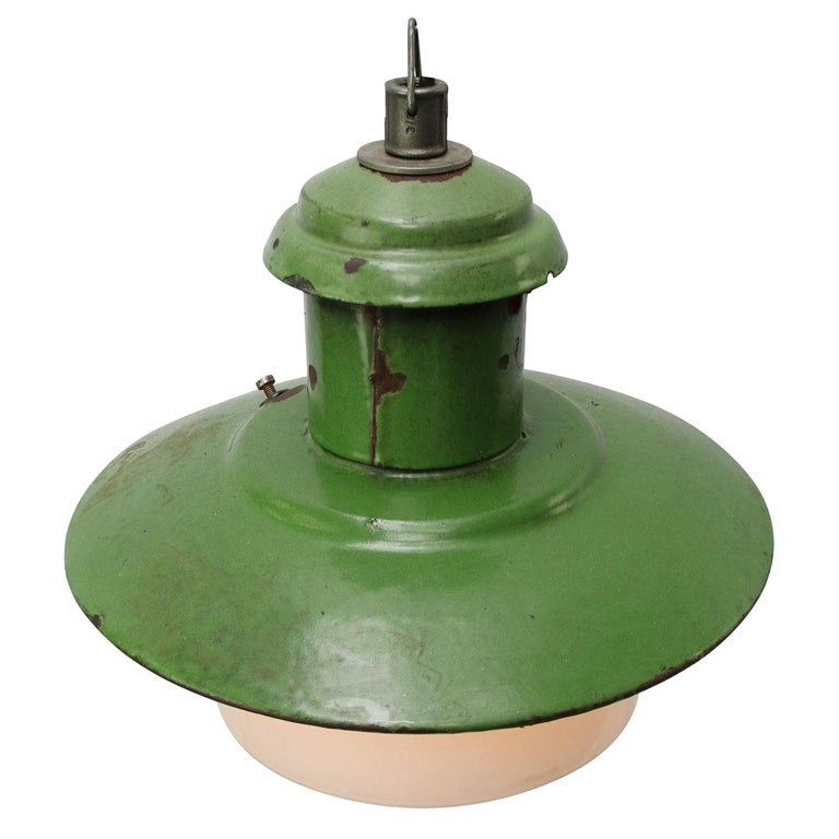 Green enamel factory pendant. White inside. White opaline glass  Measure: Diameter glass 21 cm  Weight: 2.20 kg / 4.9 lb  Priced per individual item. All lamps have been made suitable by international standards for incandescent light bulbs,