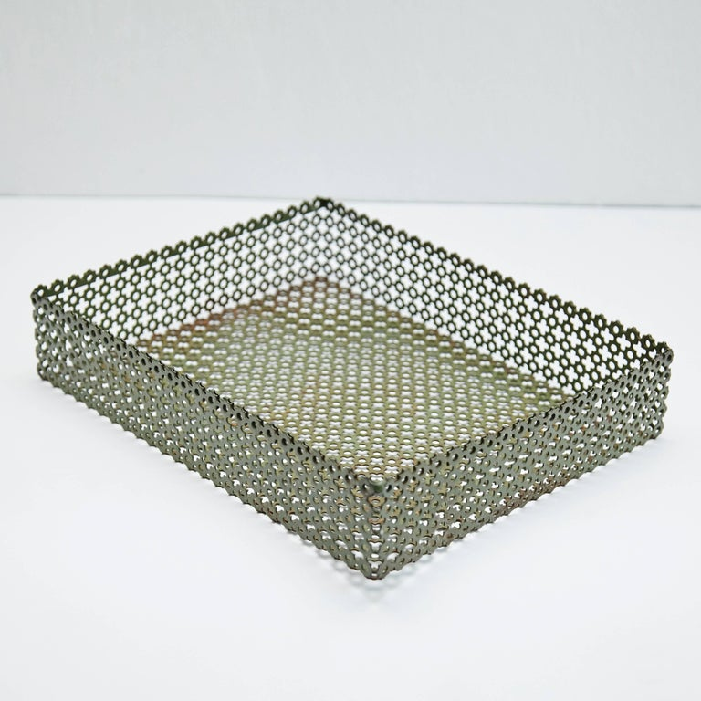 Enameled metal tray designed after Mathieu Matégot. Manufactured in France, circa 1950. Lacquered perforated metal with original paint.  In original condition, with minor wear consistent with age and use, preserving a beautiful patina.