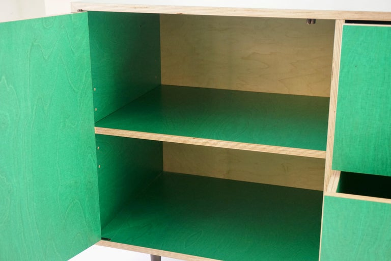 Contemporary Green Finn-Ply Cabinet with Bronze Pulls and Turned Bronze Legs For Sale