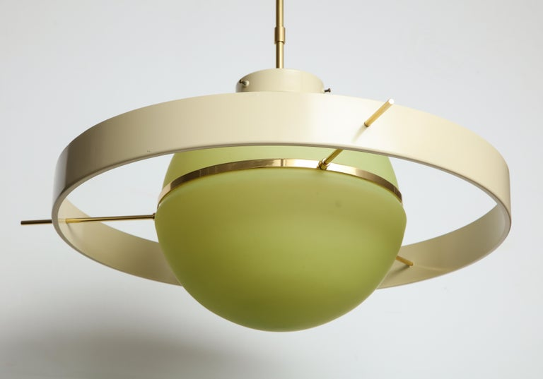 A great vintage Italian light with frosted green glass globe and brass detailing.