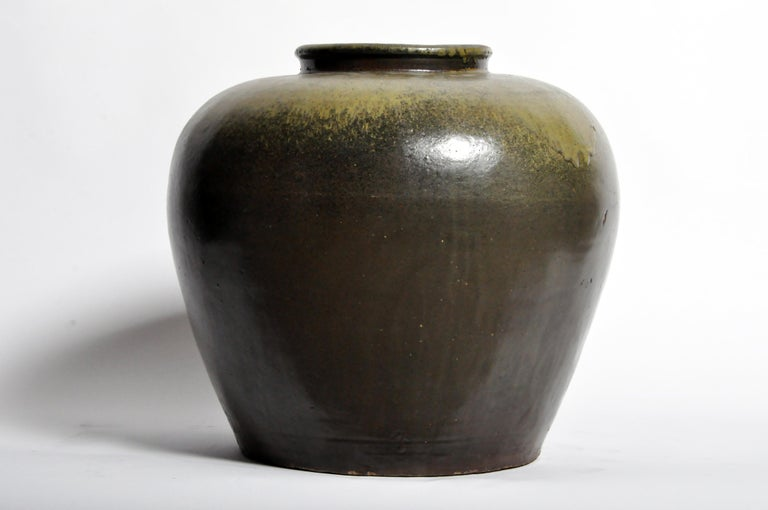 This green glazed pot is from China and was made from ceramic, circa late 1800s. Wear consistent with age and use.