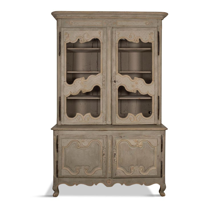 Green-gray painted buffet deux-corps, French buffet deux-corps painted in a soft muted green-grey accented by a secondary color of cream-ivory.