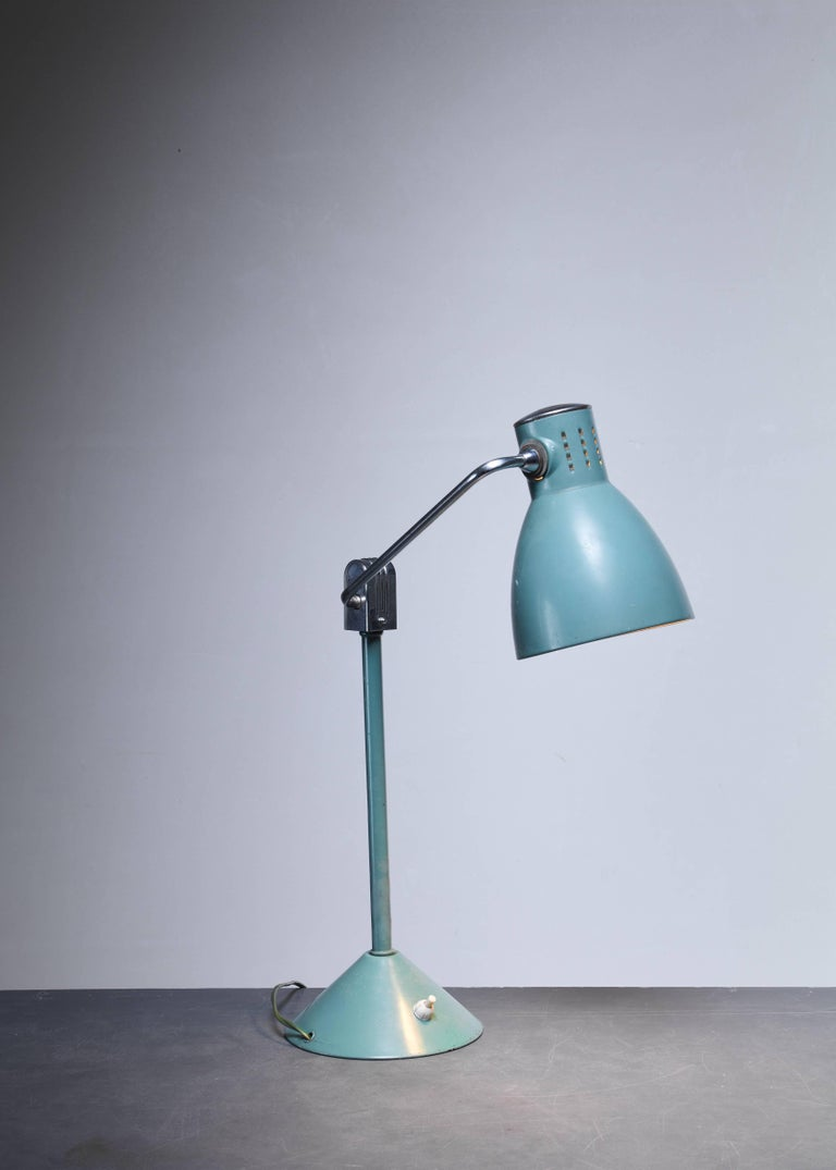 A model '800 S' table lamp by Jumo, in a beautiful soft blue/green. Both the arm and the shade are adjustable.