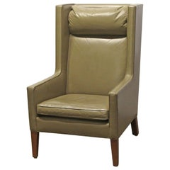 Green Leather Reading Chair with Dark Wood Tone Frame