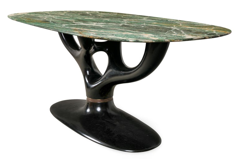An amazing table with incredibly beautiful Italian marble and a spectacular ebonized organic base.