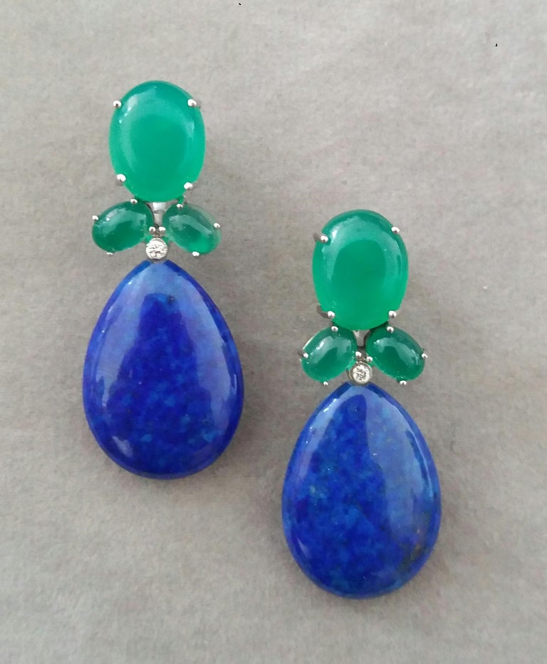 Elegant and completely handmade Earrings consisting of an upper part of 3 oval shape Green Onyx in different sizes set together in 14 Kt yellow gold with 2 small diamonds in the bottom, in the lower part we have 2 Natural Color Lapis Lazuli Flat