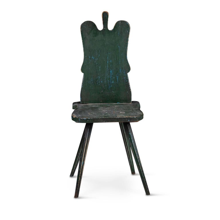 Green painted Swedish Folk Art chair, circa 1780. Pegged construction vernacular side chair in layers of early milk paint: green over blues.