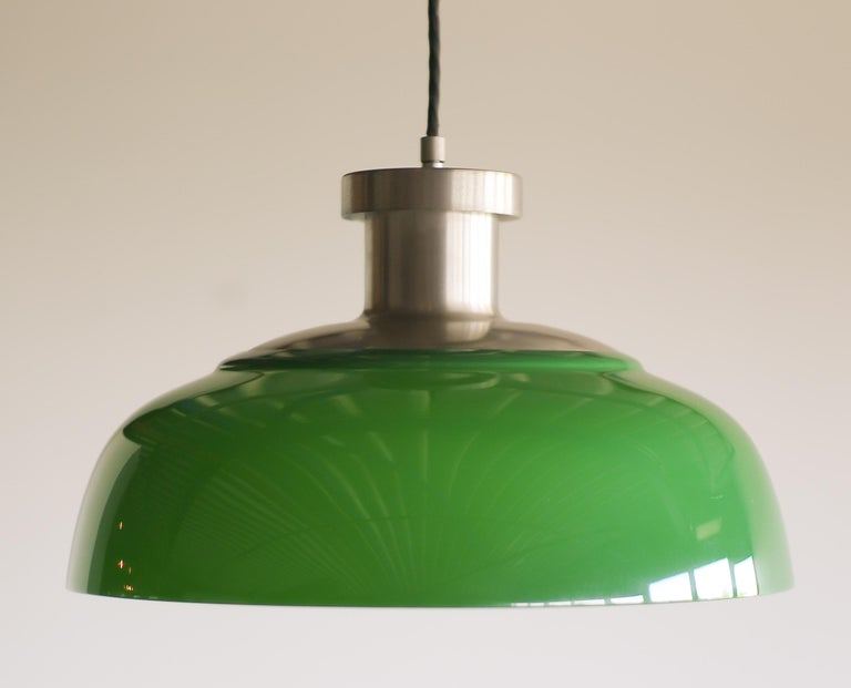 Rare pendant, this was the first lighting design by Achille Castiglioni. Made of nickel-plated steel with an acrylic shade it looks very contemporary, but it is vintage Mid-Century Modern! Wired for use in the USA.