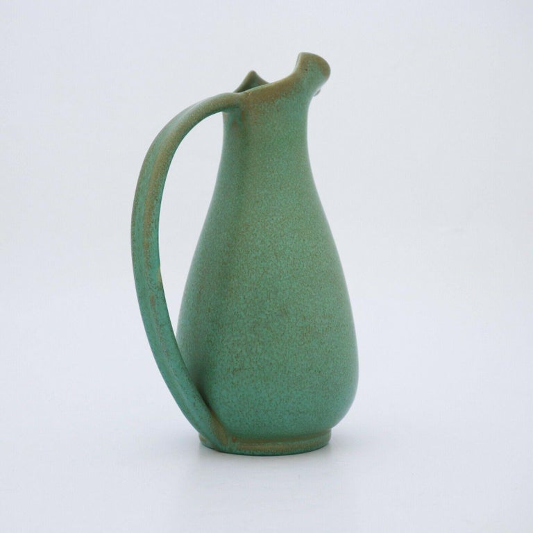 A lovely pitcher designed by Ewald Dahlskog in the 1930s at Bo Fajans in Gefle, Sweden. It is 26.5 cm high and in perfect condition.