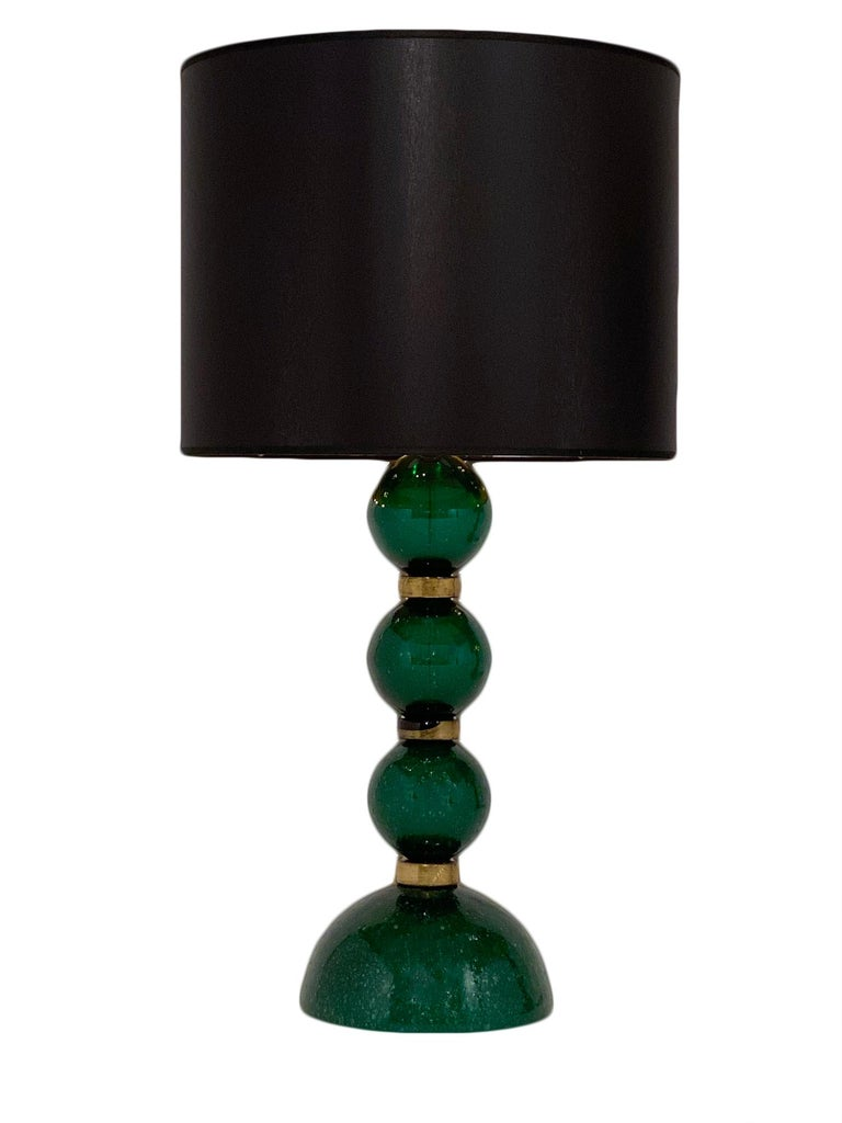 Murano glass green Pulegoso lamps signed by Alberto Donna, Murano. This pair is hand blown using the Pulegoso technique. We love the unique color and affect. This pair has been newly wired to fit US standards.
