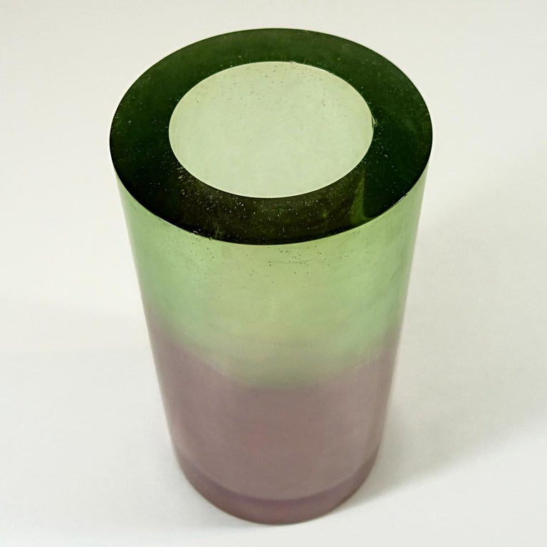 This vase is made of resin and fiberglass by American artist Steve Zoller. He is unique in his use of color, elemental shapes and flamboyant style. In 1993 he made this beautiful vase together with a floor lamp, a table lamp, a sconce and another