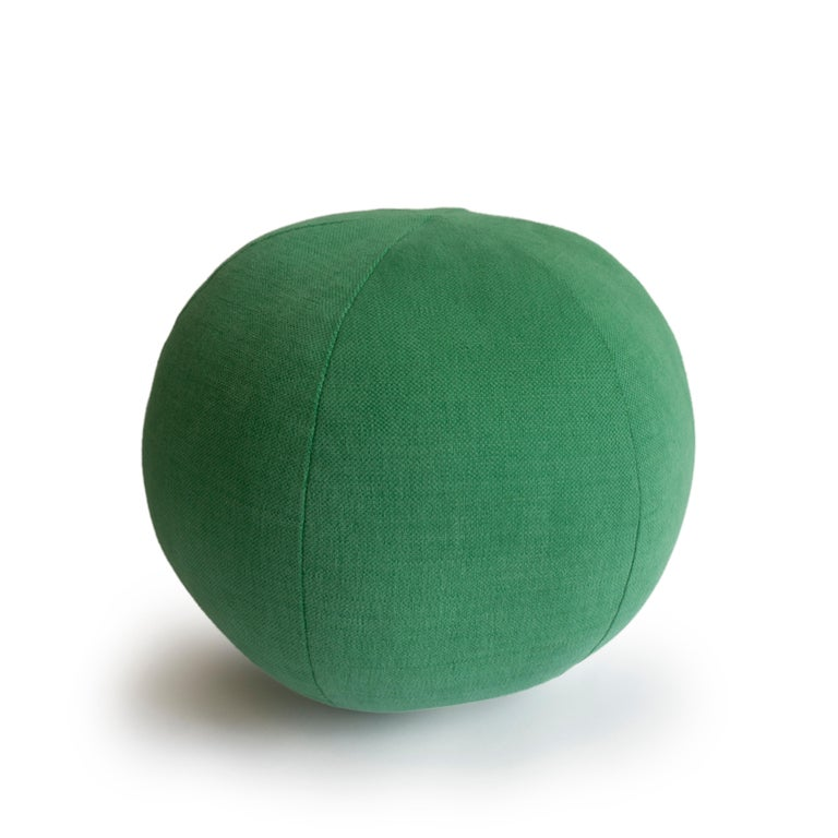 This hand sewn round ball throw pillow was handmade in a green cotton fabric. All pillows are made at our studio in Norwalk, Connecticut.   Measurements: 9
