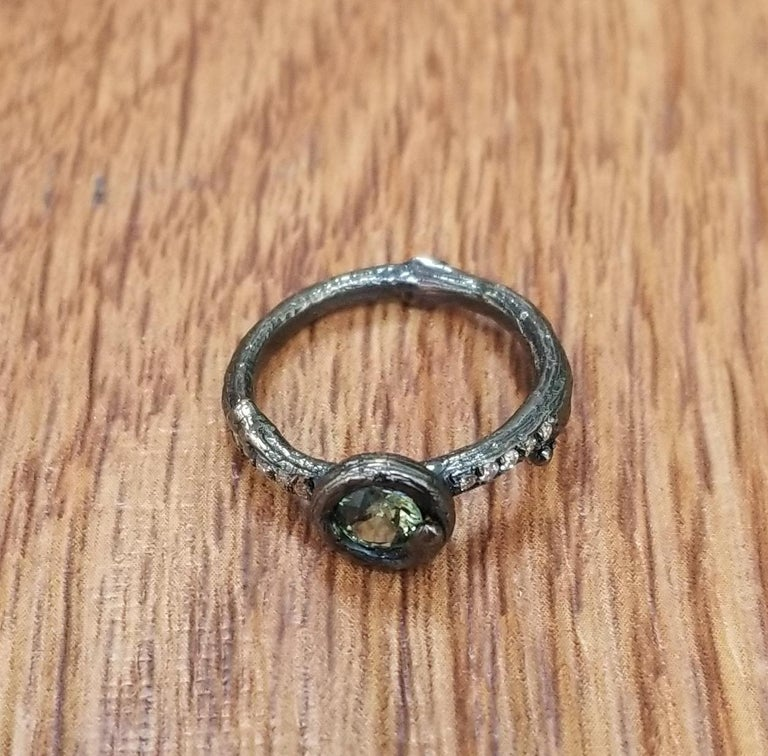 14k white gold Gresha signature bark ring with 5mm green sapphire weighing .50pts. and 10 diamonds weighing .10pts. ring has been black rhodium.  *Rings are stackable*  *this design is ours and can be created in any other form; ring, necklace,