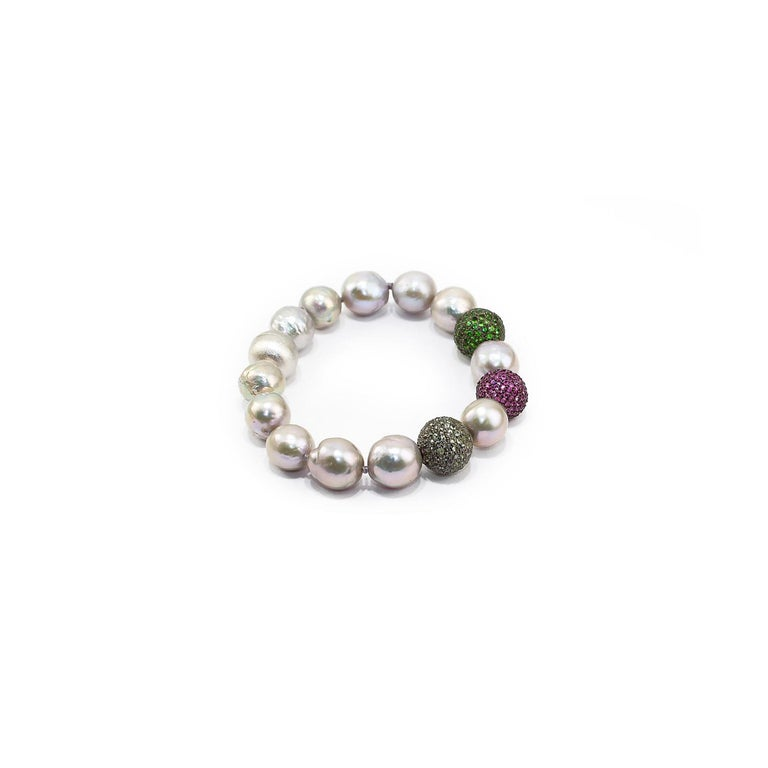 Nice bracelet made up of green sapphires, rubies and tsavorite pave on silver setting, baroque grey pearls and 925 satin silver clasp.  Green sapphires pave ct. 1,79 Rubies pave ct. 2,26 Tsavorite pave ct. 2,07 Baroque grey pearls 925 satin silver