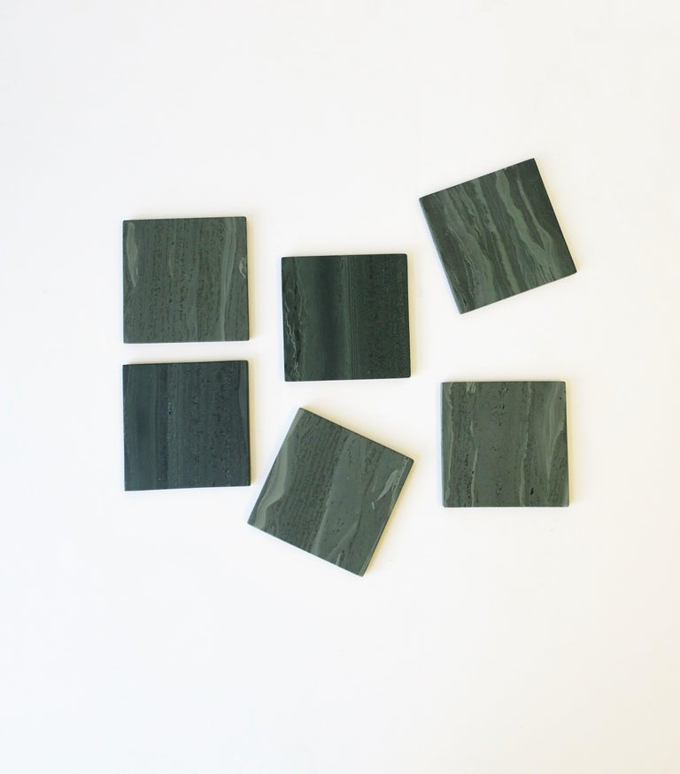 A beautiful set of six Minimalist or modern style green square stone coasters for drinks, cocktails, champagne, etc. Coasters are a dark green with traces of light green throughout. A great addition to any bar, bar cart, or entertaining area, and a