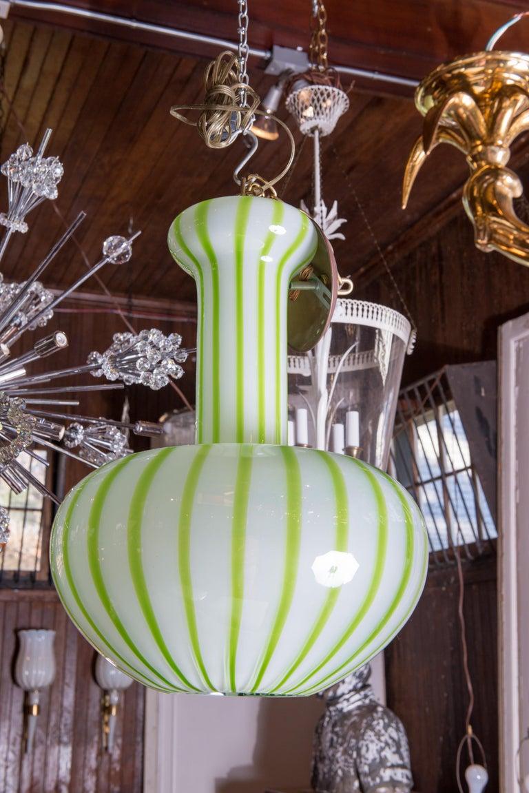 Venetian Murano glass green striped pendant light.