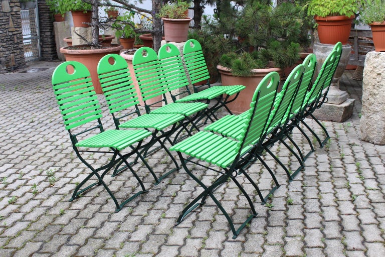 Modern ten green foldable vintage garden chairs 1980s, which were made of dark green lacquered metal frame and light green lacquered ash wooden slats. Easy to handle, the garden chairs or patio dining chairs are foldable The chairs are very stable