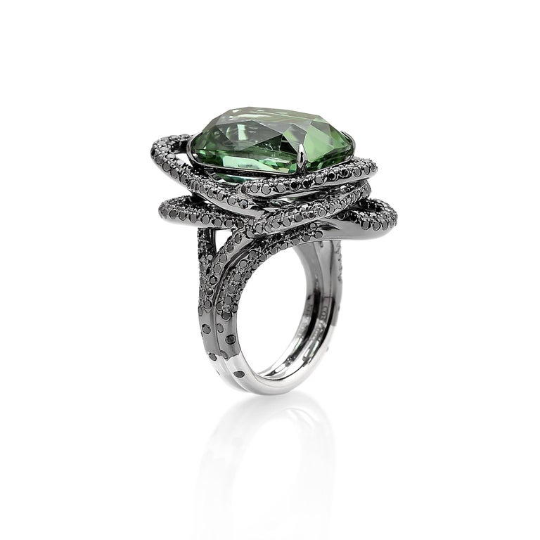 From the 'Intrecci' Collection, faceted cushion shape green tourmaline ring set in 18 karat white gold with black rhodium finish and pave-set black diamond detailing.   The beauty is in the details - from the combination of hues, the cut of the