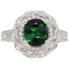 Green Tourmaline and Diamond Halo Ring in 18 Karat White Gold