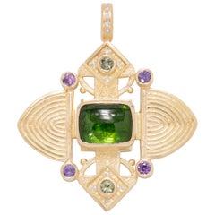 Green Tourmaline Ashanti Cross Pendant in 18 Karat Gold with Purple Sapphires