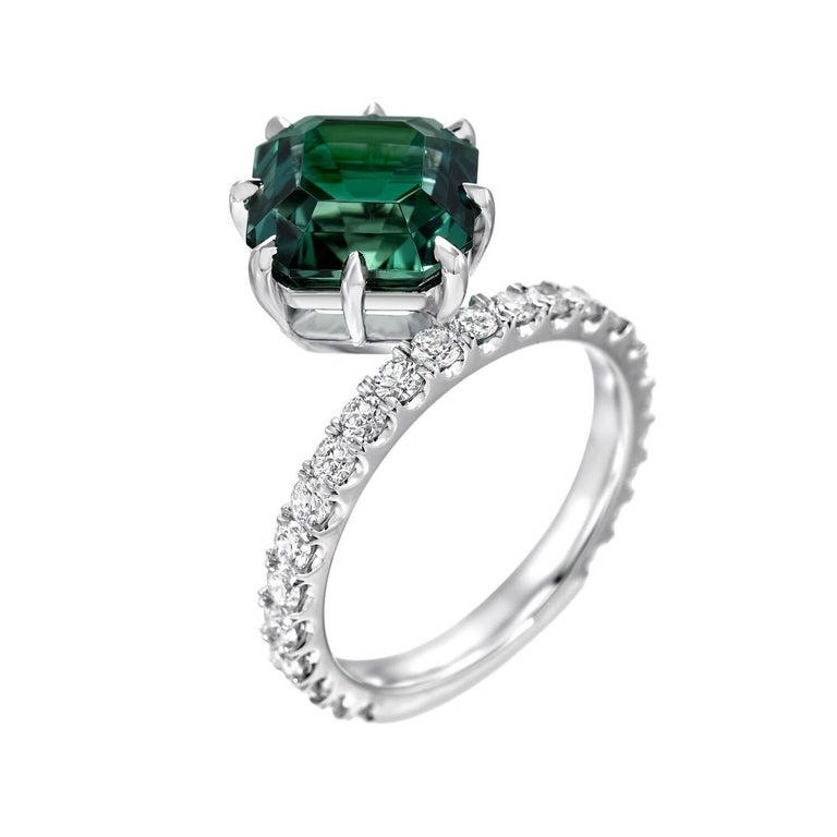 Superb 4.17 carat square emerald cut, vivid Green Tourmaline and 0.82 carat total round brilliant diamonds are hand set in this unique 8 claw prong cocktail platinum ring. This vibrant Green Tourmaline showcases superior color, cut and