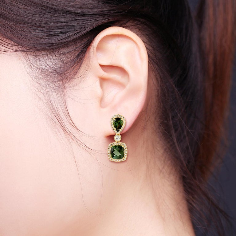 These beautiful drop earring are handcrafted in 18-karat gold. It is set with 3.94 carats tourmaline and .64 carats of glimmering diamonds.  FOLLOW  MEGHNA JEWELS storefront to view the latest collection & exclusive pieces.  Meghna Jewels is proudly