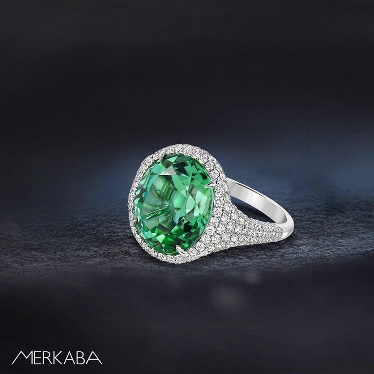Natural, unheated 10.40 carat Mint Green Tourmaline oval, is hand set in this 1.58 carat round brilliant diamond, platinum ring. Size 6.5. Resizing is complementary upon request. Crafted by extremely skilled hands in the USA.   Returns are accepted