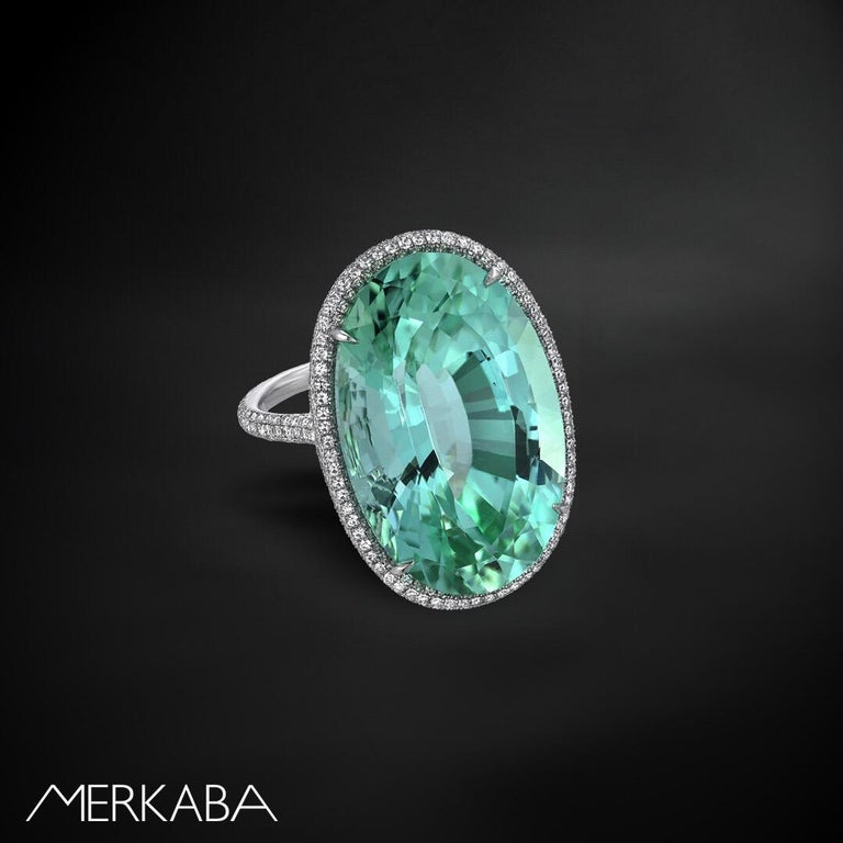 Natural, unheated 33.85 carat Mint Green Tourmaline oval, is hand set in this 1.87 carat completely micro pave diamond, platinum ring. Size 5.75. Resizing is complementary upon request. The DSEF certificate is attached to the images for your