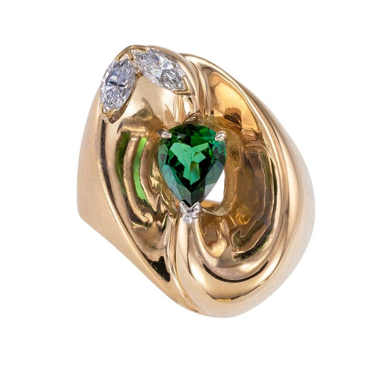 Green tourmaline diamond and yellow gold cocktail ring circa 1970.   Clear and concise information you want to know is listed below.  Contact us right away if you have additional questions.  We are here to connect you with beautiful and affordable