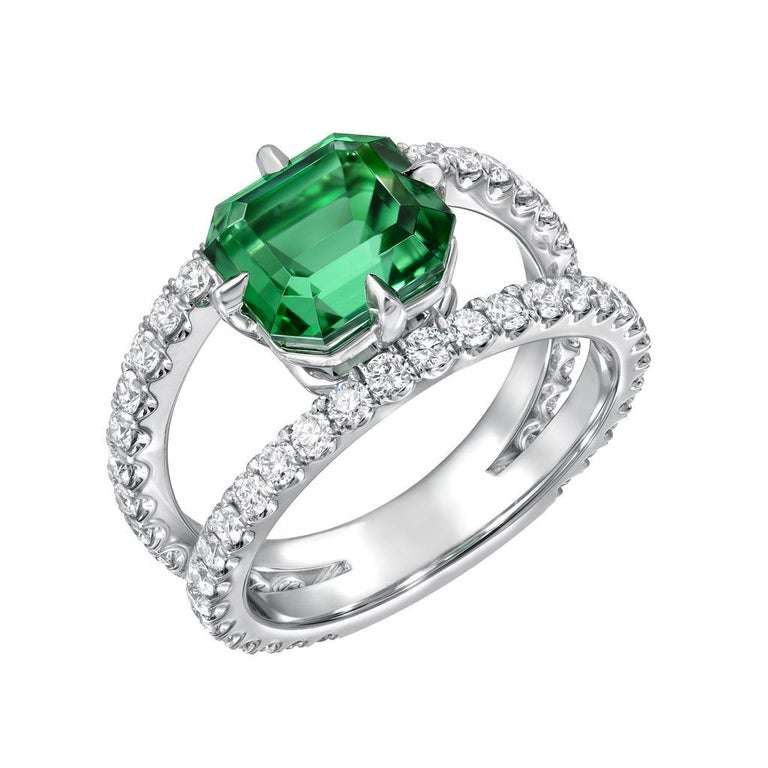 This vIbrant 2.76 carat Green Tourmaline Emerald Cut, is set in an ultra fine double shank diamond platinum cocktail ring, created by Merkaba Jewelry. This Green Tourmaline represents the finest of its kind globally, and is out of reach for the