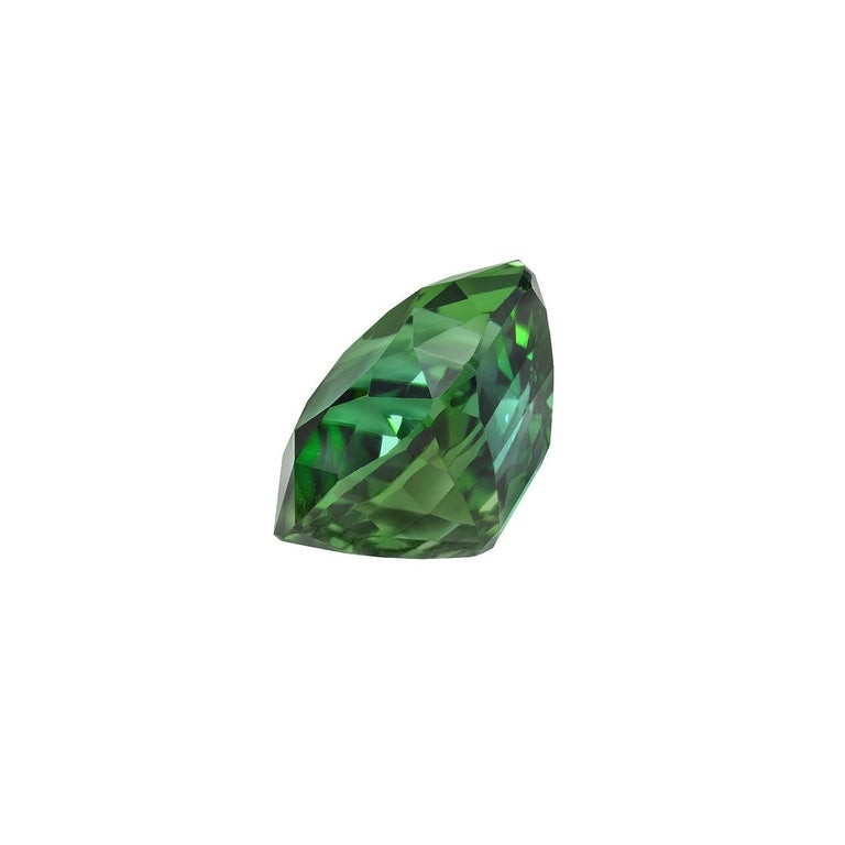 6.51 carat Green Tourmaline cushion gem, offered loose to a gemstone lover. Returns are accepted and paid by us within 7 days of delivery. We offer supreme custom jewelry work upon request. Please contact us for more details. For your convenience we