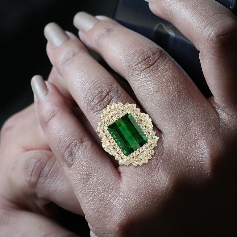 Stunning Green Tourmaline Ring with Rosecut Diamond in 18K Yellow Gold.  Ring Size: 7 ( can be sized for a price )   18KT: 8.820gms DIAMOND: 1.64cts TOURMALINE: 10.44cts