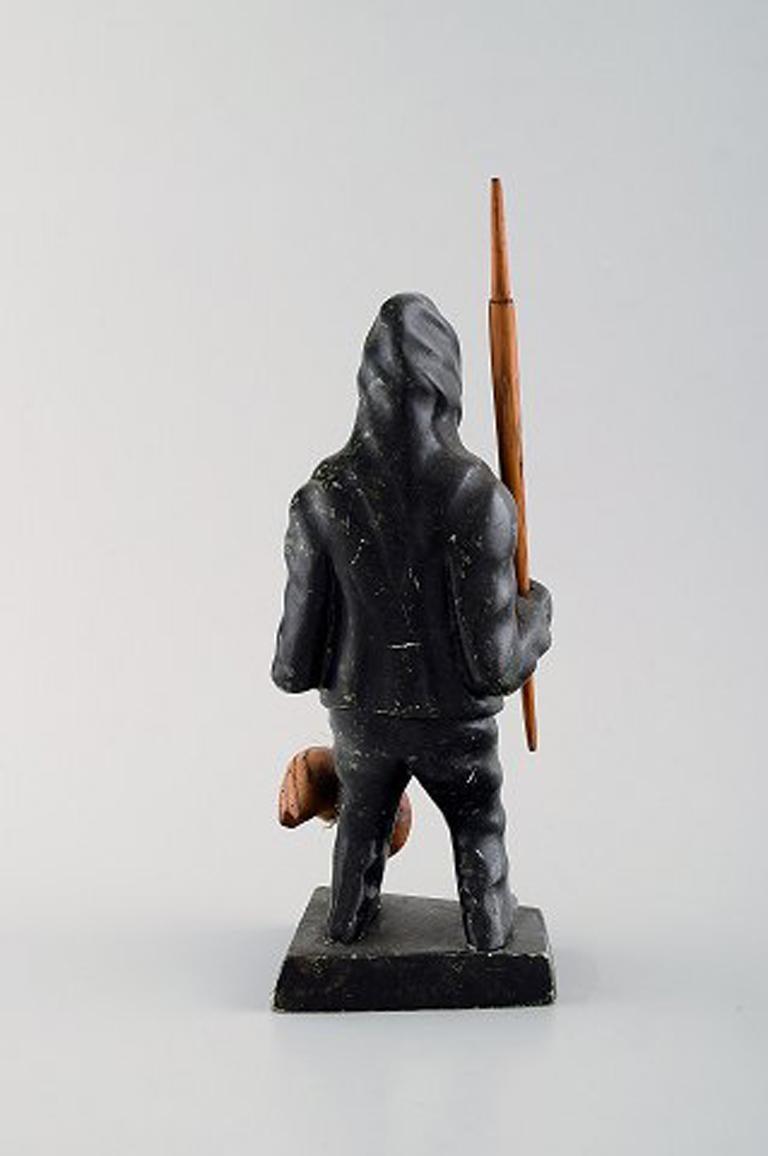 Folk Art Greenlandica, figure of catcher carved in soap stone. For Sale