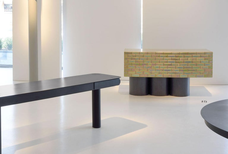 Equal parts utilitarian and pop art, this sideboard by Gregor Jenkin is made of electroplated mild steel and brass with raw steel legs.   Jenkin is widely lauded as one of South Africa's foremost designers. A self-proclaimed 'maker of things', his