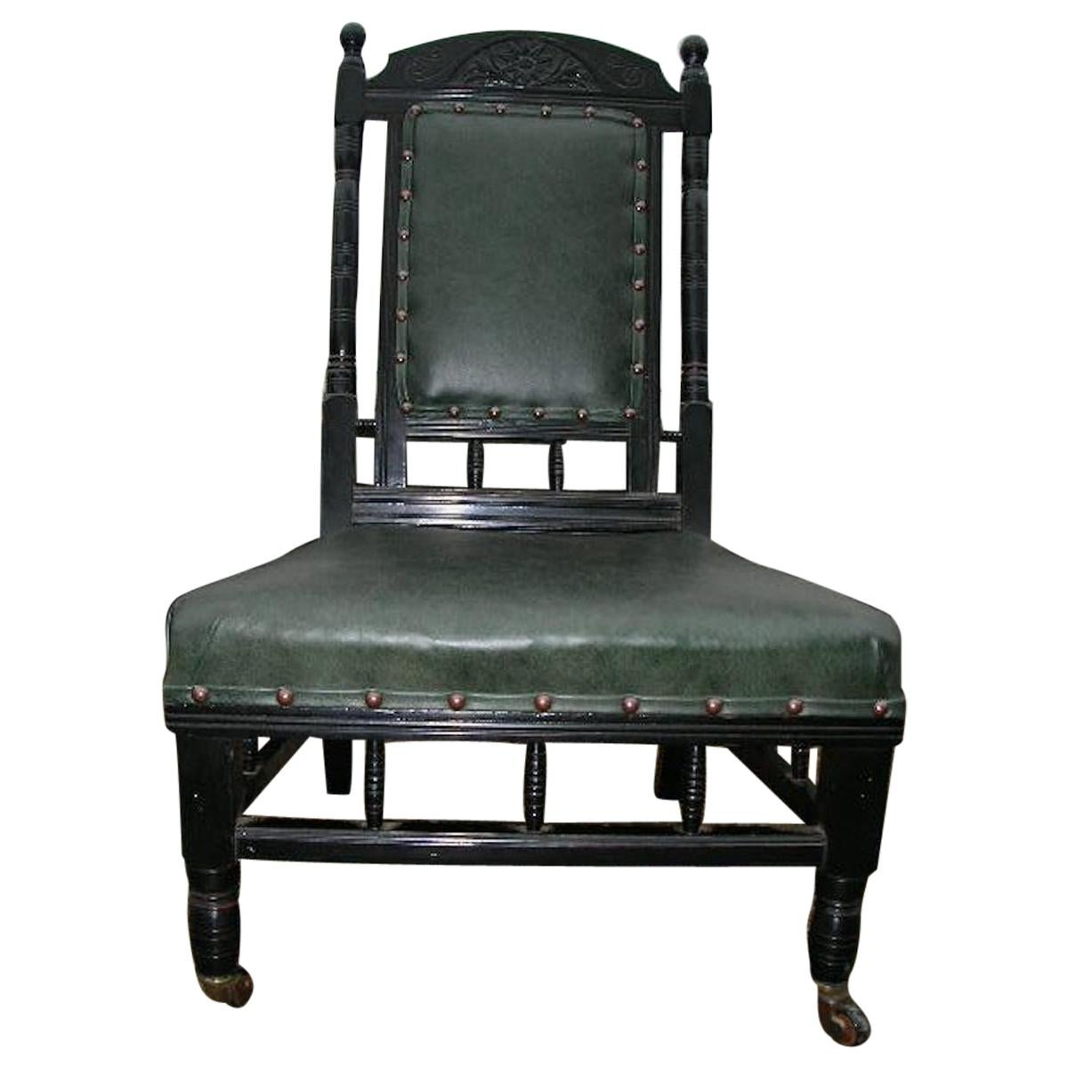 Gregory & Co. London, an Aesthetic Nursing Chair with Stylized Carved Sunflower