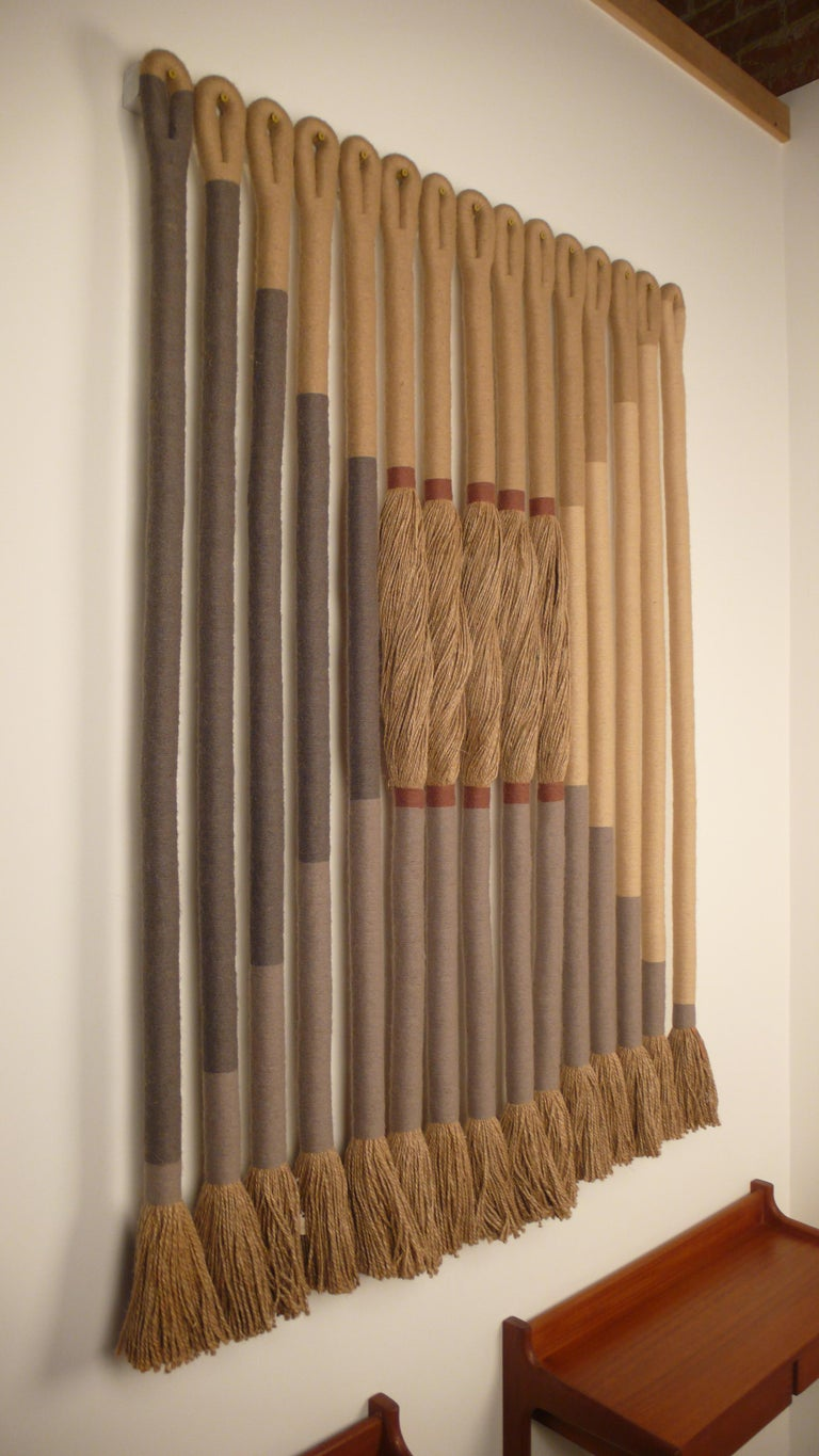 'Greige' by Fiber Artist Jane Knight, 1928-2013. Comprised of 15 elements signed with copper metal label. Excellent condition.  Jane Knight (1928-2013) was born in Grosse Pointe and received her BFA from the University of Michigan in 1951. After