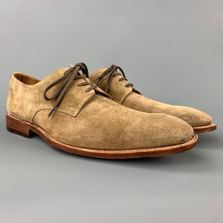 GRENSON dress shoes comes in a tan suede featuring a cap toe, leather detail, wooden sole, and a lace up closure.   Very Good Pre-Owned Condition. Marked: 5025 9 F  Outsole: 12.5 in. x 4 in.